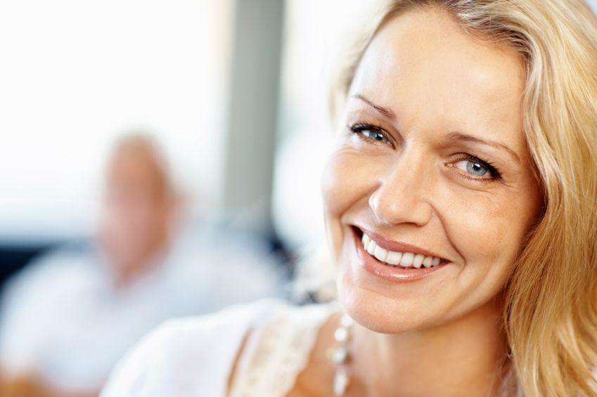 A woman smiles | cosmetic dentistry concord nh