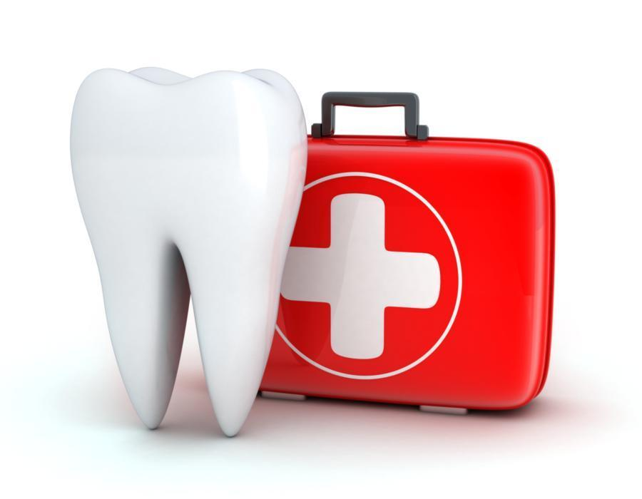 An image of a tooth and a first aid kit | Concord NH root canals & extractions