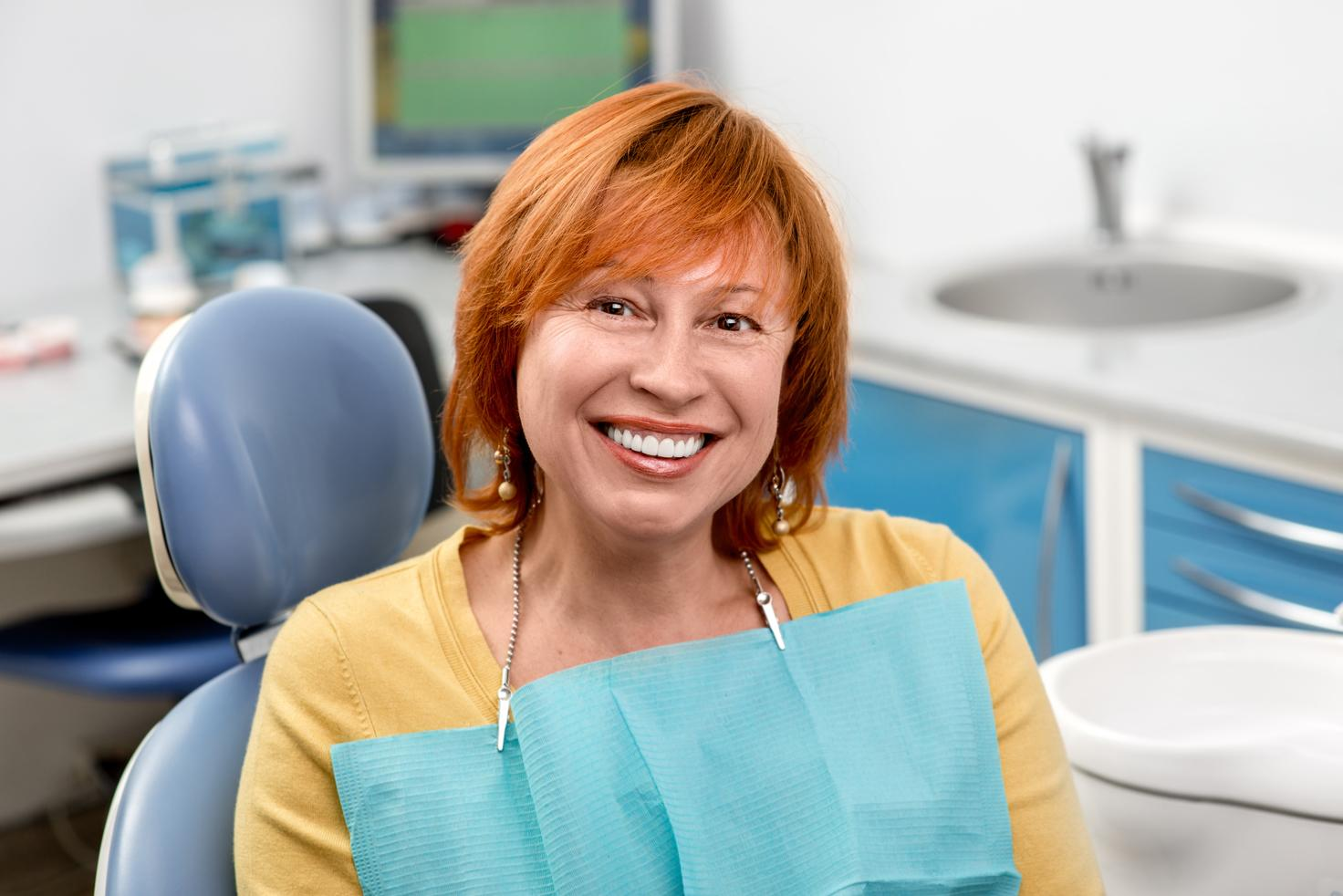 A Woman smiles in the dental chair | dental fillings concord nh